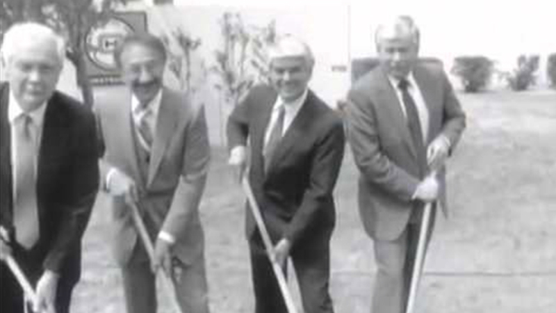 Black and white photo of four men with a shovel at the Proton Therapy groundbreaking